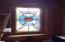 Stained glass sidelights on fireplace