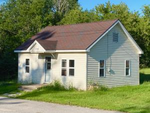 2 bedroom 1 bath home with mudroom and detached storage shed.