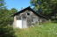 back side of building in rough shape & lean too. Sold as is. Does have a septic & drainfield.