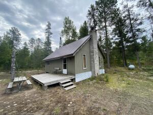 Off-grid cabin with metal roof on 40 acres