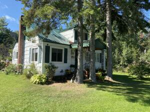 Rich with local history this property can serve you as a home or a opportunity to have a business in the thriving UP - located across from local beach access and community park, youll love and appreciate all the work that has gone into restoring this beautiful home and rec building -