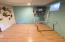 Basement rec room. Finished and could be extra living space.