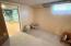 Basement utility room/storage area.