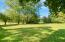 Back yard. 1/2 acre+/- in size. Lots of space for your RV or boat.