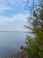 133.33' of Waterfront on the St. Mary's River, Sugar Island. Paved Rd, only 10 minutes from the Ferry. Electric Available