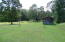 back yard with chicken house/storage shed and barn below