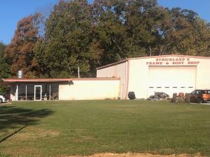 shop, storage facility and 4 acres