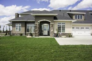 Stone & Steel Siding on Home! Photo of similar model.