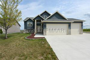 Immaculate home on a corner lot one block from a new school!
