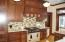 Top notch appliances, counter tops and cabinetry