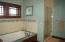Master bath with soaking tub, lge tile shower, heated floors