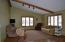 Lots of natural light, beam,wood floors