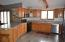 Nice size kitchen with lots of sunlight, cabinets, counter space.