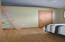Main floor bedroom with a loft