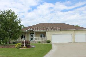 Welcome home! Located on hole #3 of the Casselton Golf Course the views will amaze you!