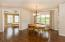 Dining area flows into sunroom and kitchen