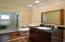 Beautiful cherry hardwood floor and tile shower