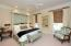 Main floor guest bedroom offers privacy and beautiful views