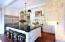 Granite counters and custom cabinetry abound
