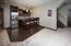Island, wet bar, wine fridge, dishwasher and side by side refrigerator