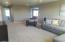 This space can be used as a family room or play room.