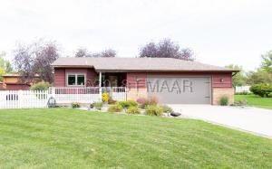 Beautiful landscaping, wood deck and 2 stall attached garage