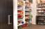 Pantry equipped with barn door and it's own mini fridge & heated floors.