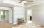 Double doors, tray ceiling and recessed lighting
