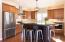 Kitchen features SS appliances, including gas range and 2 full sized ovens.