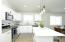 White painted cabinets throughout.