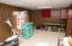 Basement rec room has built in storage.