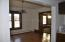 Formal Dining Area is open to the kitchen. Beautiful windows and woodwork.