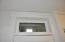 Decorative Transom Window above stairwell to attic.