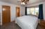 Master bedroom with walk-in closet and en-suite bath
