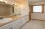 Double sinks and linen closet