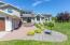 Meticulous landscaping and many mature trees and plantings.