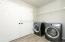 Lots of space for laundry and storage. Doors to mechanical area. Washer and Dryer are not included.