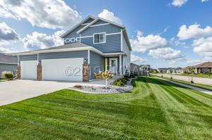 Beautiful Landscaping in large Yard with sprinkler system!