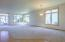 Open concept living room/dining area.