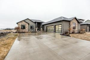 Sleek, modern exterior with angled garage.