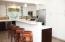 Enjoy meals at the kitchen island. Tons of kitchen storage in the floor to ceiling cabinets!