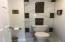Master suite features a private toilet/shower room with gorgeous tile work!