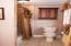 Second story guest bathroom w/ bathtub.