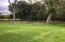 This expansive back yard could serve as whatever you can imagine! Even another garden!