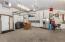 Cabinets, Gas Heater & Service Door to Backyard