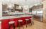 Oversized Island, Gourmet Kitchen Appliances, Custom Cabinetry, Pantry, Undercabinet Lighting, Pot Filler & Marble Backsplash