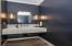 Custom Marble Floating Counter, Accent Lighting, Plumbing & Crown Molding