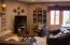 This cozy family room sits right off the kitchen and dining room.