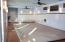 Large indoor pool room. Retractable cover offers additional safety for all.
