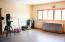 This bonus room (previously an attached 2 stall garage) is 18'x30' and is currently used as a workshop. The sky is the limit with this space!